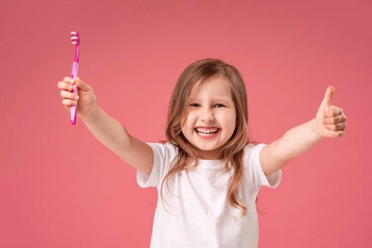 little girl with brush