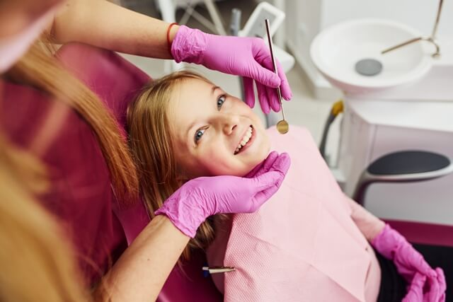 little-girl-visiting-dentist